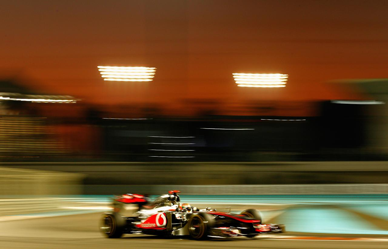 ABU DHABI, UNITED ARAB EMIRATES - NOVEMBER 13:  Lewis Hamilton of Great Britain and McLaren drives on his way to winning the Abu Dhabi Formula One Grand Prix at the Yas Marina Circuit on November 13, 2011 in Abu Dhabi, United Arab Emirates.  (Photo by Paul Gilham/Getty Images)