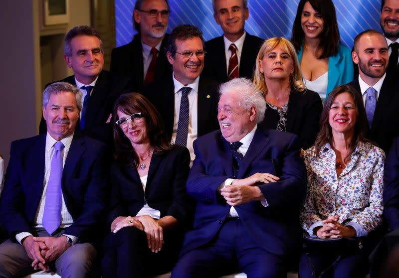 Argentina's incoming Health Minister, Gines Gonzalez Sola laughs as Argentina's President-elect Alberto Fernandez announces his cabinet, ahead of taking office, in Buenos Aires