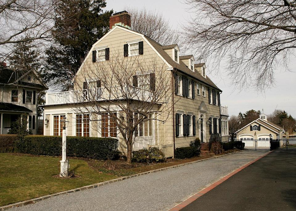 NEW YORK - MARCH 31:  Real estate photograph of a house located at 112 Ocean Avenue in the town of Amityville, New York March 31, 2005. The Amityville Horror house rich history and beauty are overshadowed by the story of George and Kathy Lutz, the previous residents of 112 Ocean Avenue, who claimed that shortly after moving into the house they fled in terror driven out by paranormal activity. The best selling novel and popular movie have marked the town as the site of the most famous haunted house in history, yet many are unaware that the true history of this house is much darker than
