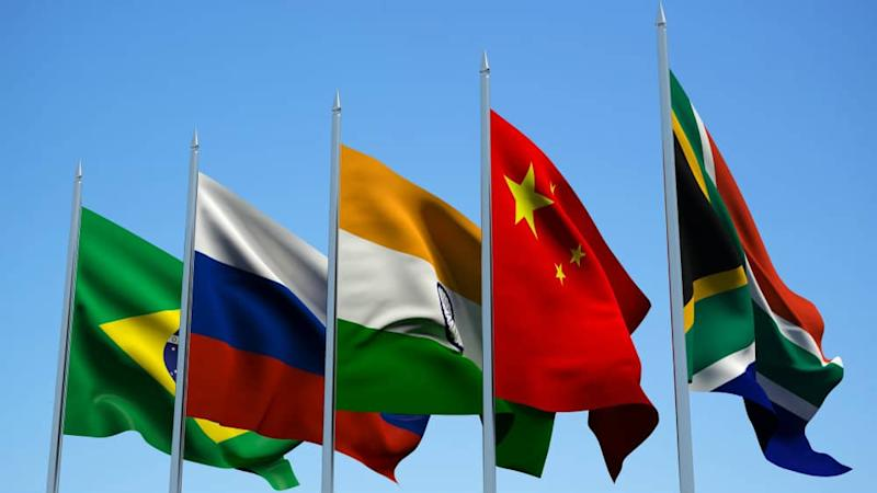 National flags of Brazil, Russia, India, China and South Africa on poles