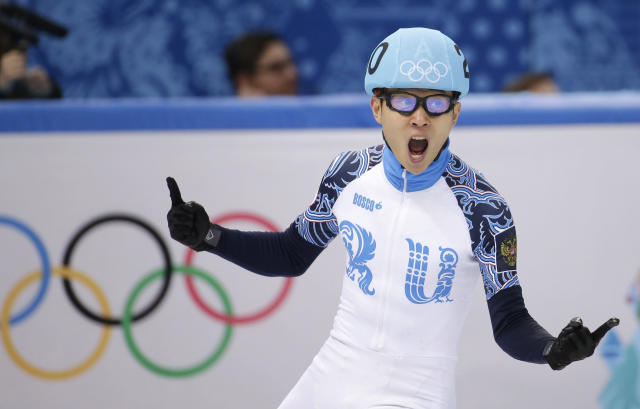 Victor An of Russia celebrates after his first place in the men's 500m short track speedskating final at the Iceberg Skating Palace during the 2014 Winter Olympics, Friday, Feb. 21, 2014, in Sochi, Russia. (AP Photo/Bernat Armangue)