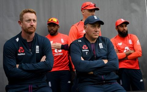 <span>Chris SIlverwood and Paul Collingwood await the delayed start of the fifth T20I in Auckland</span> <span>Credit: Gareth Copley/Getty Images </span>