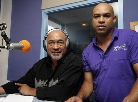 Former Surinamese dictator Desi Bouterse, head of the opposition National Democratic Party (NDP), pose with his son Dino during a live radio show in Paramaribo