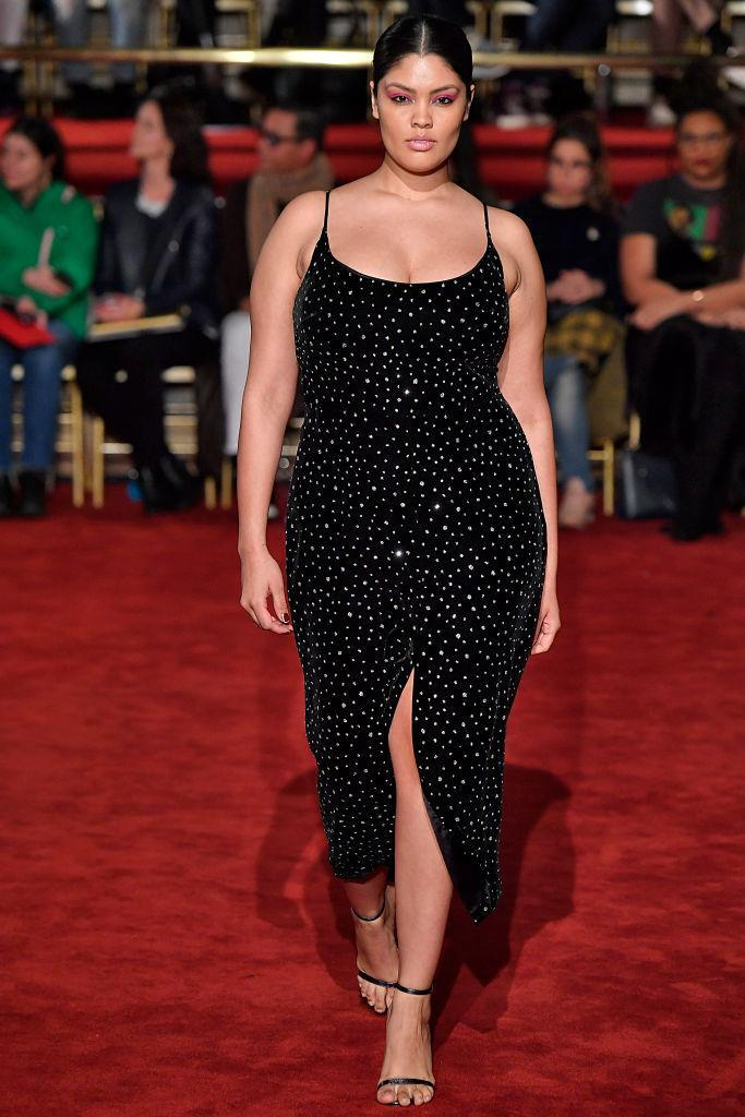 <p>A plus size model wears a black crystel embroidered dress at the Christian Siriano FW18 show. (Photo: Getty) </p>
