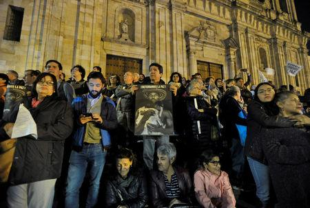 People participate in a protest against Colombia's President Duque's call for changes to the Special JEP law in Bogota