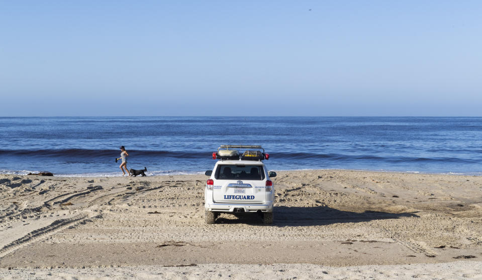 LAGUNA BEACH, CA - MAY 05: Lifeguards keep a lookout at Laguna Beach, CA after officials reopened access to the sand on Tuesday, May 5, 2020. The beach has been closed since March 23, 2020 due to the COVID-19 (coronavirus) outbreak. City parks along the beach are still closed and people cannot sit or linger on the sand. (Photo by Paul Bersebach/MediaNews Group/Orange County Register via Getty Images)