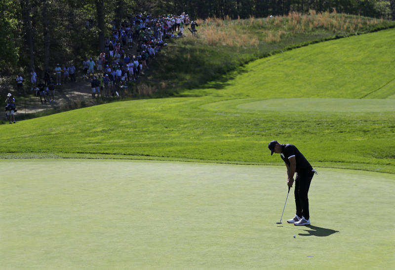 Brooks Koepka putts on the sixth green during the third round of the PGA Championship golf tournament, Saturday, May 18, 2019, at Bethpage Black in Farmingdale, N.Y. (AP Photo/Seth Wenig)