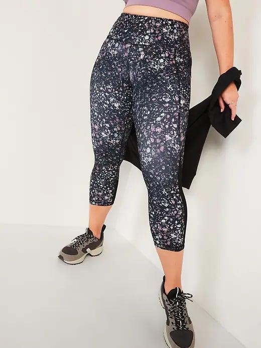 <p>The patterned <span>Old Navy High-Waisted PowerSoft Run Crop Leggings in Midnight Oil</span> ($40) would look so cute with a solid colored top in a neutral or bold hue, too.</p>