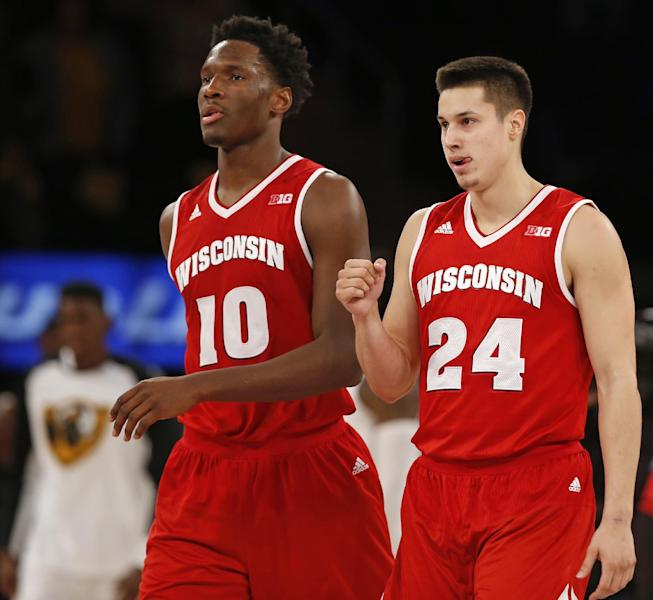 FILE- In this Nov. 22, 2015, file photo, Wisconsin guard Bronson Koenig (24) and forward Nigel Hayes (10) walk off the court after Wisconsin defeated VCU 74-73 in an NCAA college basketball game for third place in the 2K Classic in New York. Seniors Hayes and Koenig are getting one last shot to make an NCAA Tournament run. They have had accomplished careers, having played key roles on two Final Four teams. (AP Photo/Kathy Willens, File)
