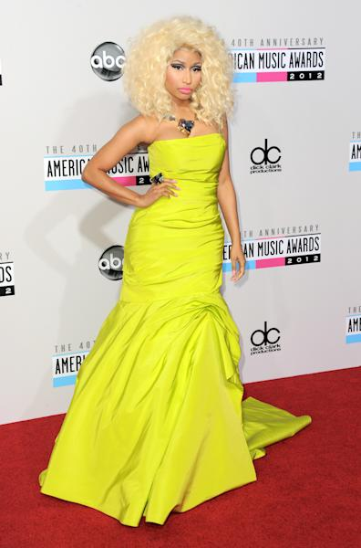 "FILE- In this Nov. 18, 2012 file photo, Nicki Minaj arrives at the 40th Anniversary American Music Awards, in Los Angeles. Despite having a big year in music, Nicki Minaj didn't receive any Grammy nominations. The 30-year-old had one of last year's biggest hits with the multiplatinum dance-pop anthem ""Starships."" Her sophomore album, ""Pink Friday: Roman Reloaded,"" has reached gold status and launched other hits on the rap and R&B charts. But Minaj was shunned out when the Grammys announced this year's nominees, though the animated performer earned three nominations last year, including best new artist and best rap album for her platinum debut, ""Pink Friday."" (Photo by Jordan Strauss/Invision/AP, File)"