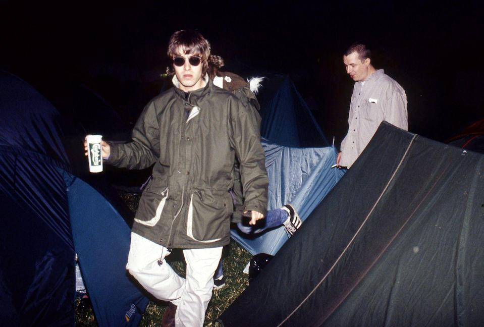 <p>Liam backstage at the Glastonbury Festival in 1995. His brother Paul is behind him. </p>