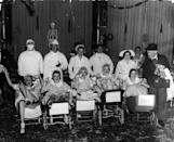 """<p>The <a href=""""http://www.thecanadianencyclopedia.ca/en/article/dionne-quintuplets/"""" rel=""""nofollow noopener"""" target=""""_blank"""" data-ylk=""""slk:Dionne quintuplets"""" class=""""link rapid-noclick-resp"""">Dionne quintuplets</a>— the first set to survive more than a week—were born in May 1934 in Ontario, Canada, and instantly became a worldwide sensation. Fearing their impoverished parents wouldn't be able to protect them from exploitation, the government placed the baby girls in a special hospital; their mother, Oliva, fought for nine years to regain custody. Here, actress Lucille Ball (front and center) and a group of friends dressed as the quintuplets for a 1935 Halloween party. </p>"""