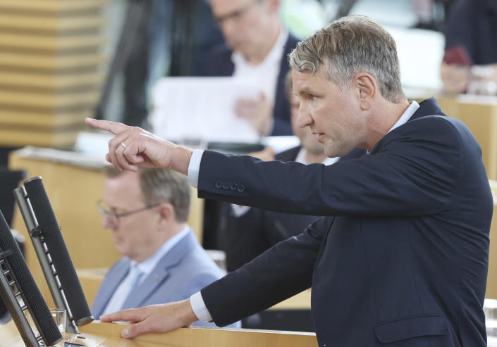 Bjoern Hoecke, parliamentary group leader of the AfD in the Thuringian state parliament, speaks before the vote in the plenary hall in Erfurt, Germany, July 23, 2021. The far-right Alternative for Germany party failed in an attempt Friday to unseat the left-wing governor of an eastern German state, a long-shot bid that opponents denounced as political theater. (Bodo Schackow/dpa via AP)