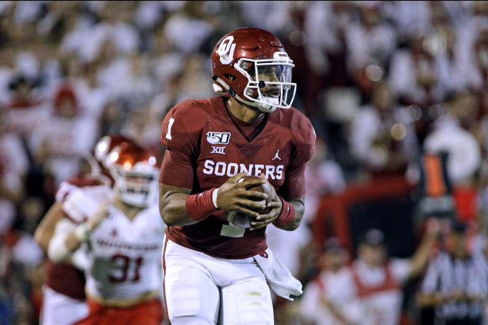 Jalen Hurts, the former Alabama quarterback, racked up 508 yards of total offense and six touchdowns in Oklahoma's win against Houston on Sunday night. (Brett Deering/Getty Images)