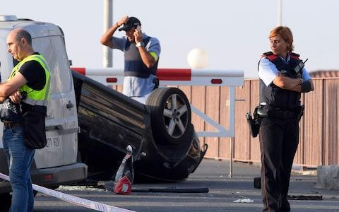 The overturned car used in the attack in Cambrils - Credit: LLUIS GENE/AFP