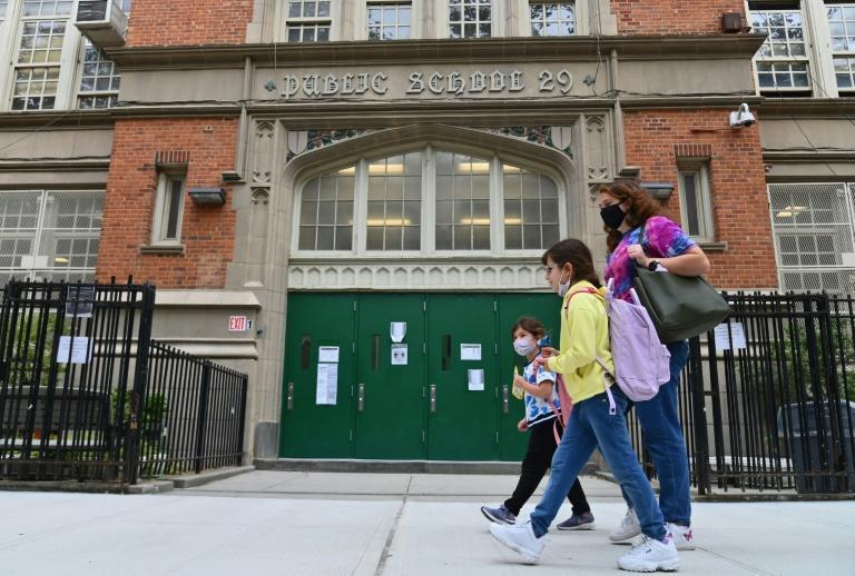 Mayor Bill de Blasio said New York's 1,800 public schools would revert to remote learning after the city recorded a seven-day average positivity rate of three percent