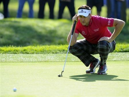 Jan 23, 2014; La Jolla, CA, USA; Ian Poulter lines up a putt on the first hole during the first round of the Farmers Insurance Open golf tournament at Torrey Pines Municipal Golf Course. Mandatory Credit: Christopher Hanewinckel-USA TODAY Sports - RTX17RVW