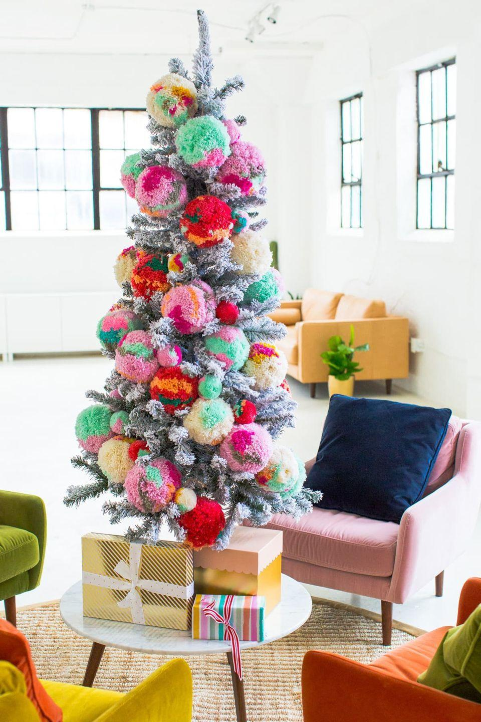 """<p>You'll instantly feel more (holly) jolly once you place multi-colored pom-poms in your artificial tree. Who needs ornaments anyway?!</p><p><em><a href=""""https://sugarandcloth.com/new-studio-sitting-area-decorated-christmas/"""" rel=""""nofollow noopener"""" target=""""_blank"""" data-ylk=""""slk:Get the tutorial at Sugar & Cloth »"""" class=""""link rapid-noclick-resp"""">Get the tutorial at Sugar & Cloth »</a></em></p>"""
