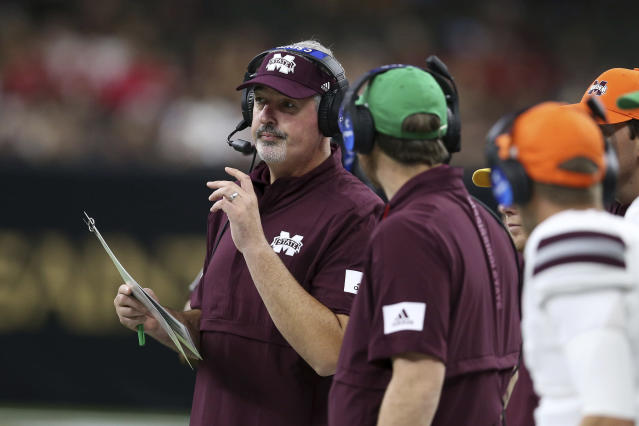 Mississippi State head coach Joe Moorhead watches on the sidelines in the second quarter of an NCAA college football game against Louisiana-Lafayette in New Orleans, Saturday, Aug. 31, 2019. (AP Photo/Chuck Cook)