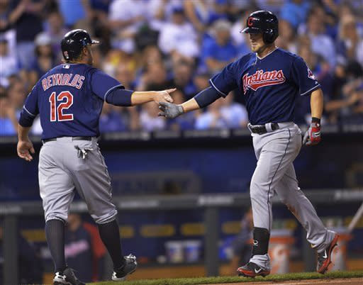 Cleveland Indians' Ryan Raburn is congratulated by teammate Mark Reynolds at home plate after hitting a home run during the fifth inning of a baseball game Monday, April 29, 2013, in Kansas City, Mo. (AP Photo/Reed Hoffmann)