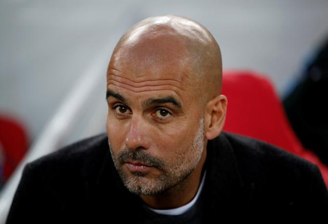 FILE PHOTO: Soccer Football - Champions League Quarter Final First Leg - Liverpool vs Manchester City - Anfield, Liverpool, Britain - April 4, 2018 Manchester City manager Pep Guardiola before the match Action Images via Reuters/Carl Recine/File Photo