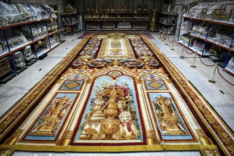 A huge royal tapestry was saved from the fire that ravaged Notre-Dame cathedral in Paris last April