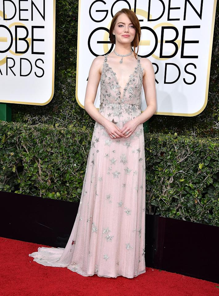 <p>Emma sparkled in a star-covered Valentino dress at the 2017 Golden Globes, where she picked up the Best Actress in a Musical or Comedy gong. [Photo: Getty] </p>