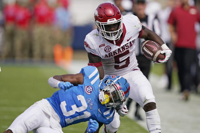 Arkansas running back Raheim Sanders (5) is knocked out of bounds by Mississippi defensive back Jaylon Jones (31) during the second half of an NCAA college football game, Saturday, Oct. 9, 2021, in Oxford, Miss. Mississippi won 52-51. (AP Photo/Rogelio V. Solis)