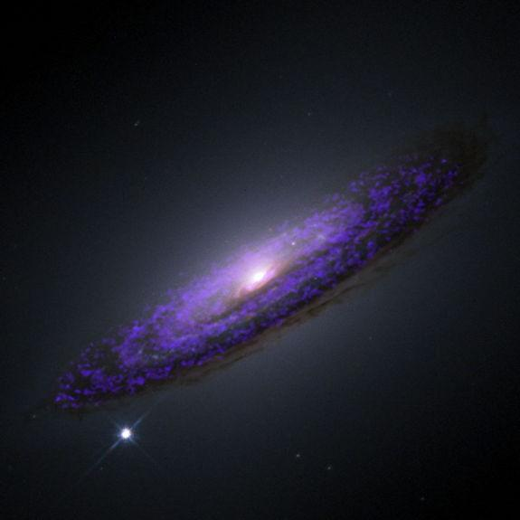 A Hubble Space telescope image of NGC 4526, overlaid with our molecular gas observations from CARMA. The black hole sits in the very center of the galaxy.