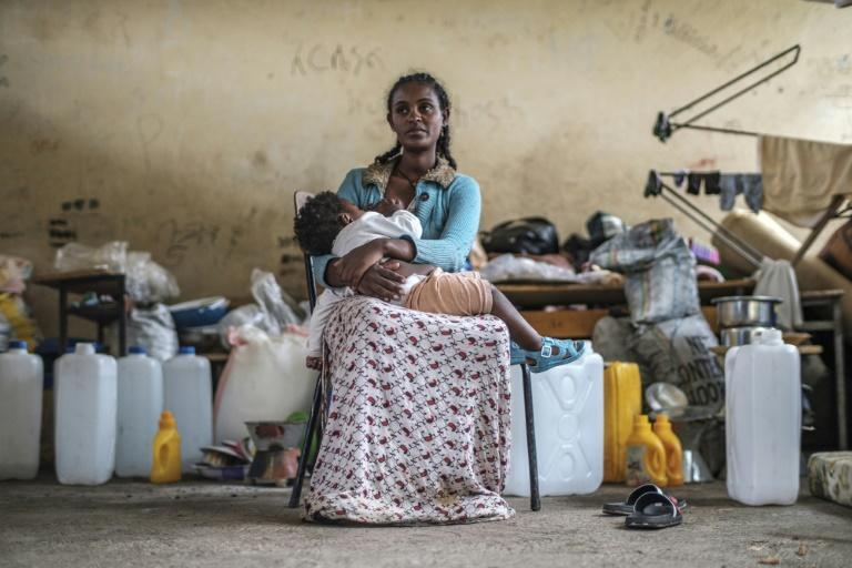 A woman and her baby displaced by fighting in northern Ethiopia have found temporary shelter at the Addis Fana School in Dessie