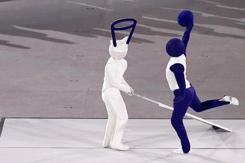 """<p>Performers recreated the 50 Olympic sports with <a href=""""https://olympics.com/tokyo-2020/en/news/pictogram-dance-sequence-at-olympic-opening-ceremony-gets-people-asking-what-is"""" class=""""link rapid-noclick-resp"""" rel=""""nofollow noopener"""" target=""""_blank"""" data-ylk=""""slk:live human pictograms"""">live human pictograms</a>, including basketball, fencing, and skateboarding.</p>"""