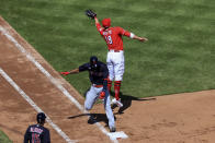 Cleveland Indians' Amed Rosario, left, reaches first base safely as Cincinnati Reds' Joey Votto, right, fields the ball during the fourth inning of a baseball game in Cincinnati, Sunday, April 18, 2021. (AP Photo/Aaron Doster)