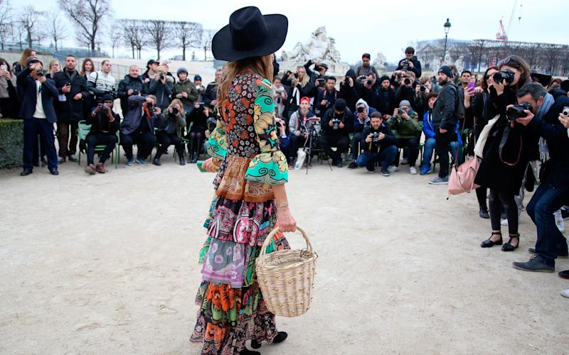 Anna Dello Russo posing for paps at Paris Fashion Week - Credit: Rex