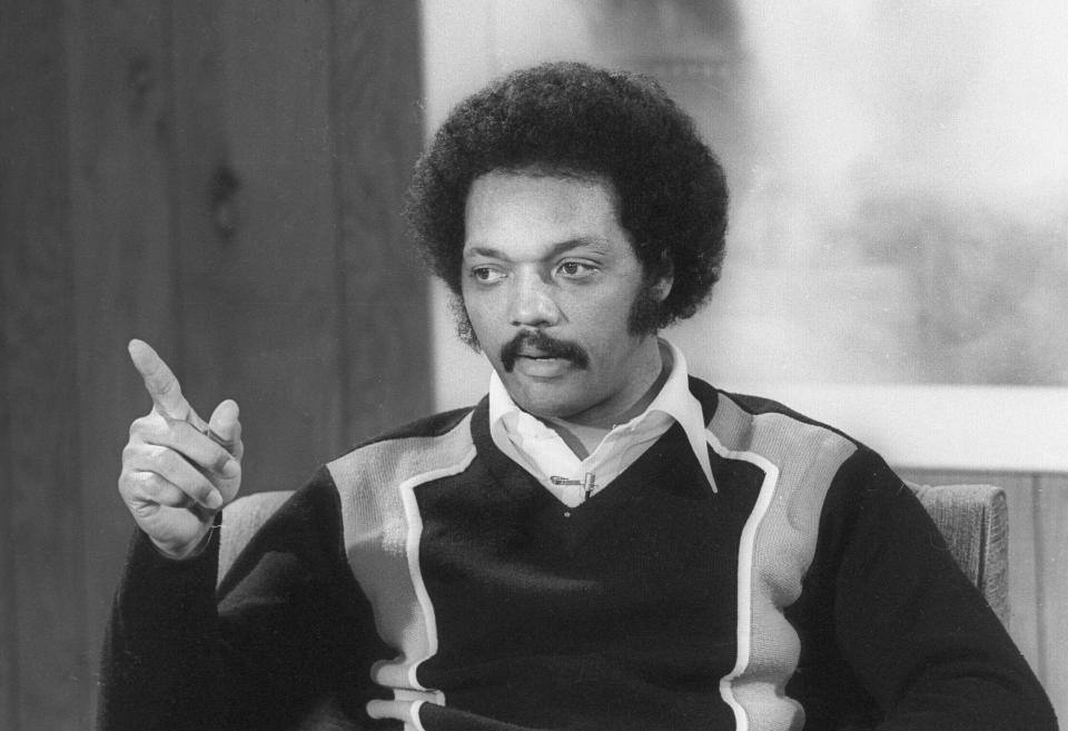 Jesse Jackson, a Babtist Minister and civil rights leader who worked with Martin Luther King, participated the Selma to Montgomery Marches, founded the civil rights organizations Operation PUSH and the Rainbow Coalition, once ran for president and sporting an Afro haircut, holds a Q&A Press Conference for staff members of the Brooks Institute of Photography, Santa Barbara, California in March, 1978. (Photo by paul liebhardt/Corbis via Getty Images)