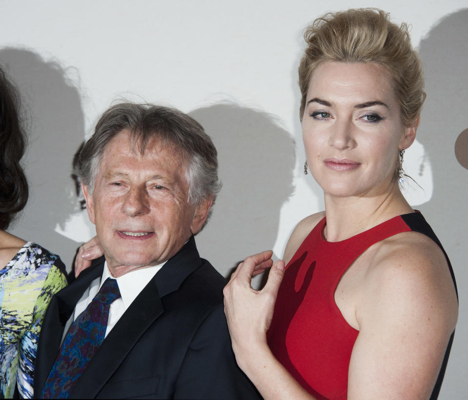 PARIS, FRANCE - NOVEMBER 20:  Kate Winslet and Roman Polanski attend the premiere of ' Carnage' at Cinema Gaumont Marignan on November 20, 2011 in Paris, France.  (Photo by Francois G. Durand/WireImage)