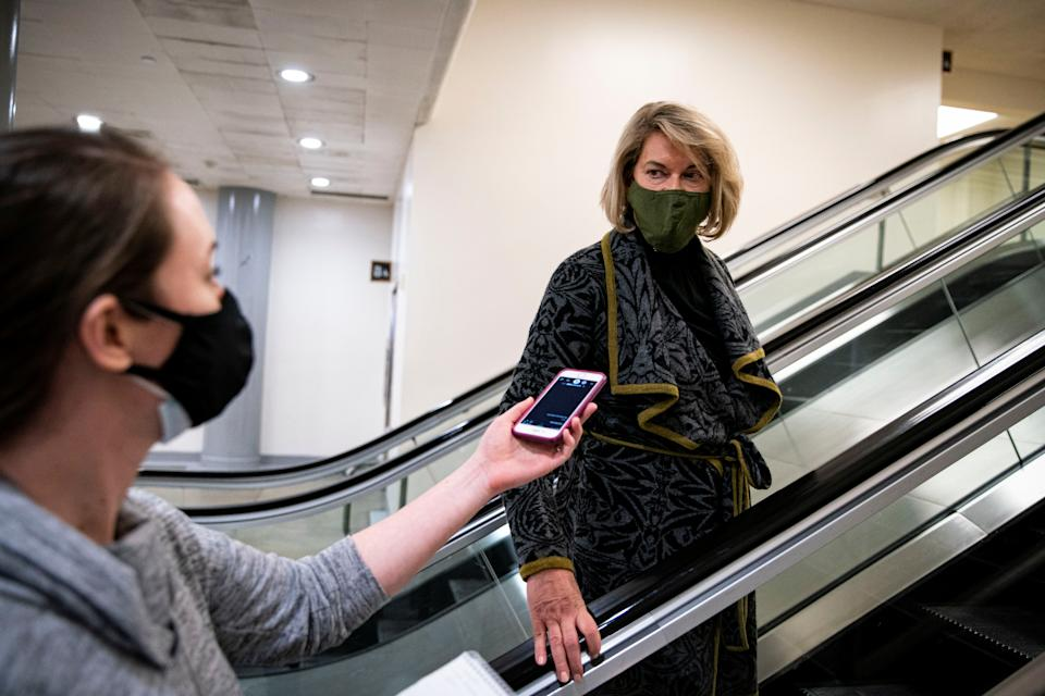U.S. Senator Cynthia Lummis (R-WY) speaks with Bridget Bowman, a reporter with CQ Roll Call, as she arrives following a break during the second day of proceedings in the second impeachment trial of former U.S. President Donald Trump on charges of inciting the deadly attack on the U.S. Capitol, on Capitol Hill in Washington, U.S., February 10, 2021. REUTERS/Al Drago