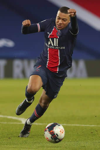 PSG's Kylian Mbappe in action during the French League One soccer match between Paris Saint-Germain and Montpellier at the Parc des Princes stadium in Paris, France, Friday, Jan.22, 2021. (AP Photo/Thibault Camus)