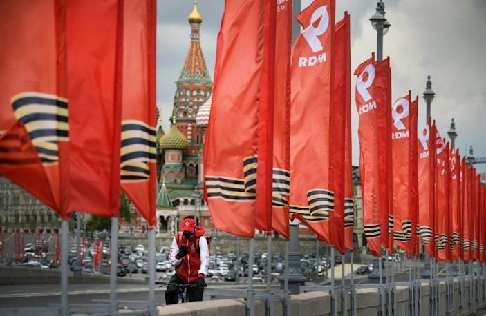 The Victory Day banners are out across Moscow but the traditional military parade will not take place on Saturday (AFP Photo/Alexander NEMENOV)