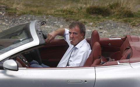 "BBC presenter of motor show ""Top Gear"" Jeremy Clarkson is pictured while he drives an Aston Martin car on Transfagarasan road close to Sibiu city, 300 km northwest from Bucharest, on September 24, 2009. The three presenters, Jeremy Clarkson, Richard Hammond and James May will drive the latest models of Ferrari, Aston Martin and Lamborghini on different roads and cities in Romania as Bucharest, Vidraru dam, Danube Delta and seacoast of Black Sea. AFP PHOTO ANA POENARIU (Photo credit should read ANA POENARIU/AFP/Getty Images) - Credit: ANA POENARIU/AFP"