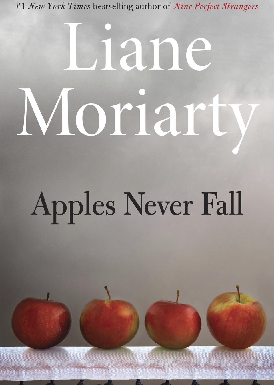 """This cover image released by Henry Holt & Company shows """"Apples Never Fall"""" by Liane Moriarty. (Henry Holt & Company via AP)"""