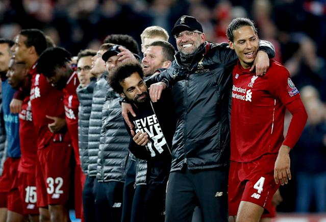 Liverpool's Mohamed Salah (left), manager Jurgen Klopp (centre) and Virgil van Dijk (right) celebrate after the final whistle Liverpool v Barcelona - UEFA Champions League - Semi Final - Second Leg - Anfield 07-05-2019 . (Photo by Martin Rickett/EMPICS/PA Images via Getty Images)