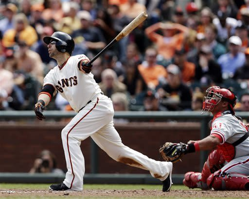 San Francisco Giants' Marco Scutaro hits an RBI single against the Philadelphia Phillies during the fifth inning of a baseball game, Wednesday, May 8, 2013, in San Francisco. (AP Photo/Marcio Jose Sanchez)