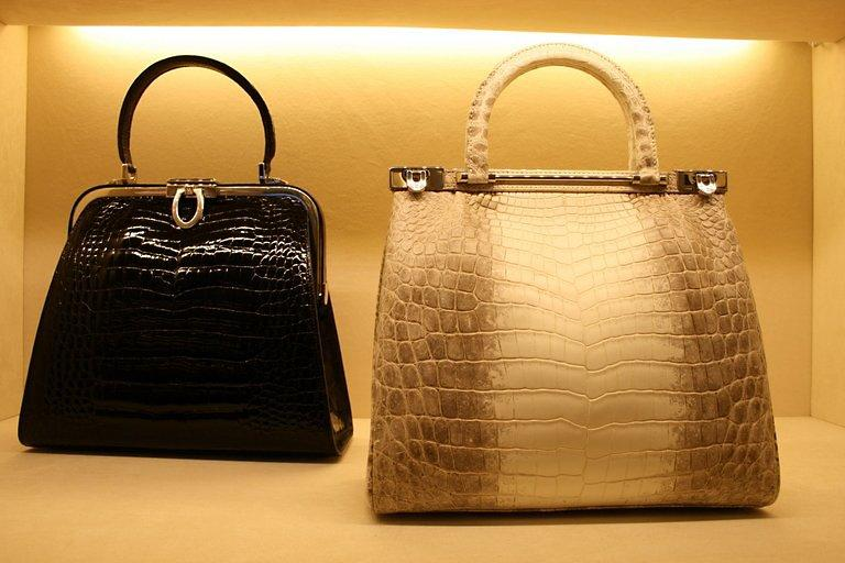 A display of crocodile skin leather handbags at a Kwanpen boutique in Singapore in March 2010. In a luxury industry dominated by famous European brands, a Singapore company is making inroads with an exclusive line of colourful handbags made from crocodile skin