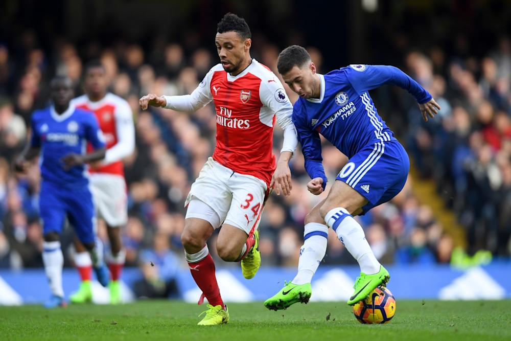 Francis Coquelin of Arsenal battles Eden Hazard of Chelsea