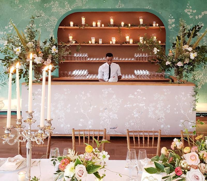 After the cocktail hour, we wanted our guests to feel as if they were walking back into our home as they entered our reception. Inspired by De Gournay, the walls of our tent were painted to look like wallpaper, and the tables were filled with sterling silver candelabras that illuminated the night.