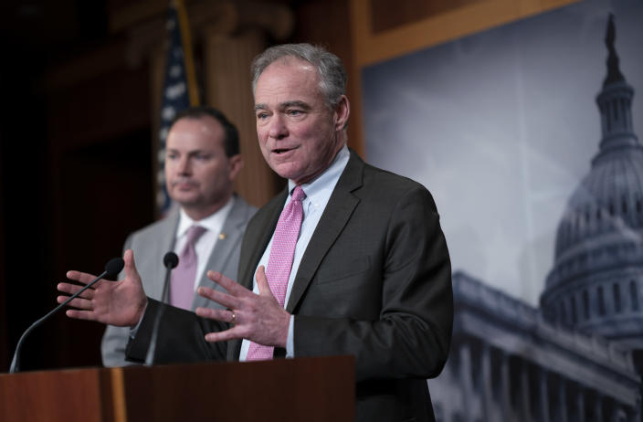 Sen. Tim Kaine, D-Va., joined at left by Sen. Mike Lee, R-Utah, meets with reporters just after the Senate advanced a resolution asserting that President Donald Trump must seek approval from Congress before engaging in further military action against Iran, at the Capitol in Washington, Wednesday, Feb. 12, 2020. (AP Photo/J. Scott Applewhite)