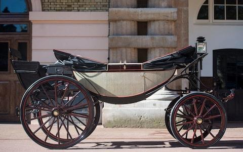 The Ascot Landau open carriage stands in the Royal Mews at Buckingham Palace in London - Credit: Victoria Jones