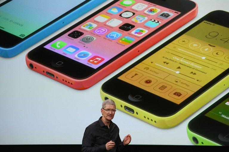 Apple CEO Tim Cook speaks about the new iPhone during an Apple product announcement at the Apple campus on September 10, 2013 in Cupertino, California