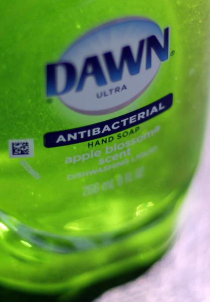 This Tuesday, April 30, 2013, photo, shows Dawn Ultra antibacterial soap in a kitchen Tuesday in Chicago. Federal health regulators are deciding whether triclosan, the germ-killing ingredient found in an estimated 75 percent of anti-bacterial liquid soaps and body washes sold in the U.S. is harmful. The ruling, which will determine whether triclosan continues to be used in household cleaners, could have broader implications for a $1 billion industry that includes hundreds of anti-bacterial products from toothpaste to toys (AP Photo/Kiichiro Sato)