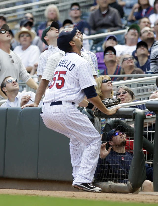 Minnesota Twins first baseman Chris Colabello joins the fans as they watch a foul ball off the bat of Oakland Athletics' Derek Norris in the fourth inning of a baseball game, Thursday, Sept. 12, 2013 in Minneapolis. (AP Photo/Jim Mone)